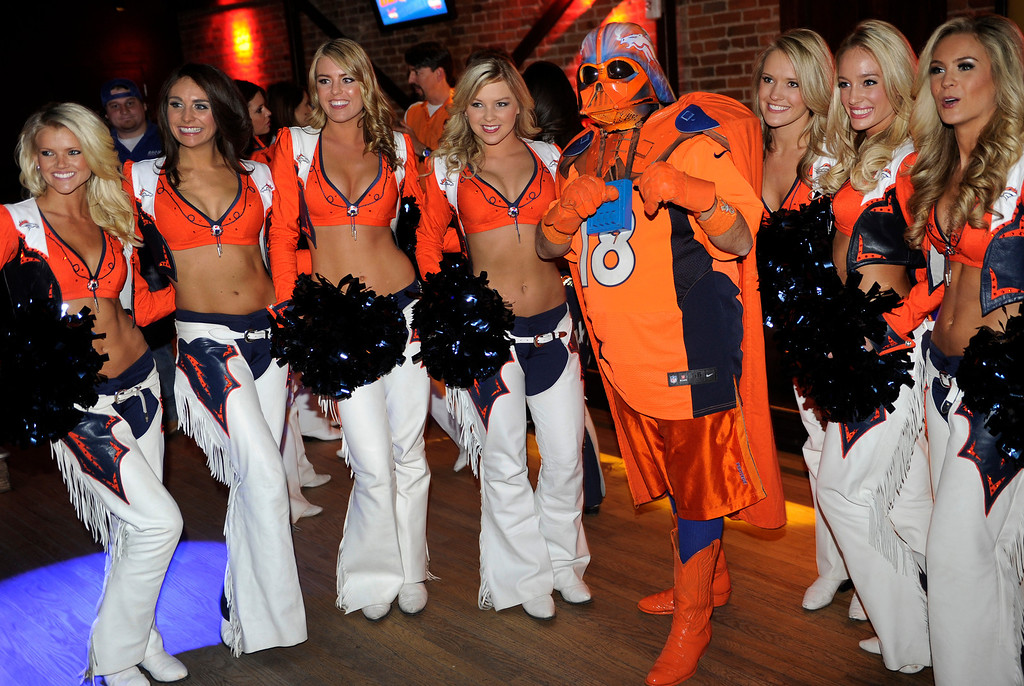 . Broncos Super Fan Orange Vader aka James Chavez posed with the Broncos Cheerleaders Thursday night. With the 28th pick Denver picked Sylvester Williams. Broncos fans gathered for a NFL draft party at the Tavern Downtown, 1949 Market Street, Thursday night, April 25, 2013. Photo By Karl Gehring/The Denver Post