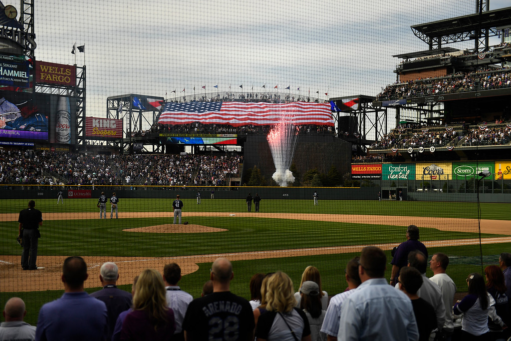 ". Denver, CO - ARRIL 08: Fans sing ""God Bless America\"" during the 7th inning stretch at the Colorado Rockies home opener against the San Diego Padres at Coors Field. April 08, 2016 in Denver, CO. (Photo By Joe Amon/The Denver Post)"
