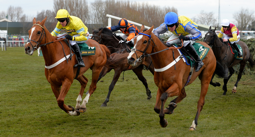 . Triolo D\'alene ridden by Barry Geraghty (L) clears the last fence leading Dunowen Point ridden by Jason Maguire (2R) on its way to winning the John Smiths Topham Steeple Chase during Ladies Day, the second day of the Grand National Meeting horse racing event at Aintree Racecourse in Liverpool, north-west England on April 5, 2013. The annual three day meeting culminates in the Grand National which is run over a distance of four miles and four furlongs (7,242 metres), and is the biggest betting race in the United Kingdom.  ANDREW YATES/AFP/Getty Images