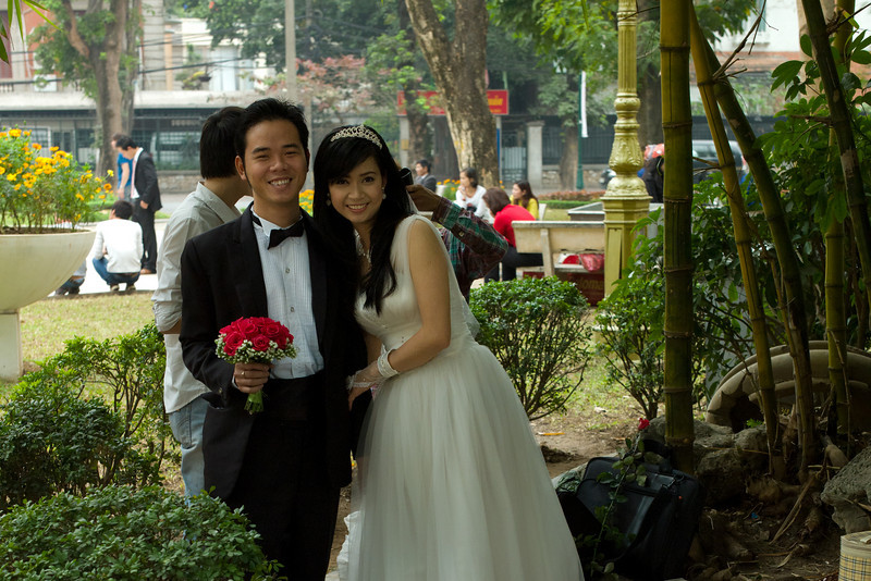 A bride-to-be and groom-to-be lakeside near the Tortoise Tower in Hoàn Kiếm Lake, Hanoi, Vietnam.