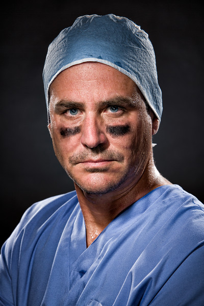 A male nurse wearing eye black.