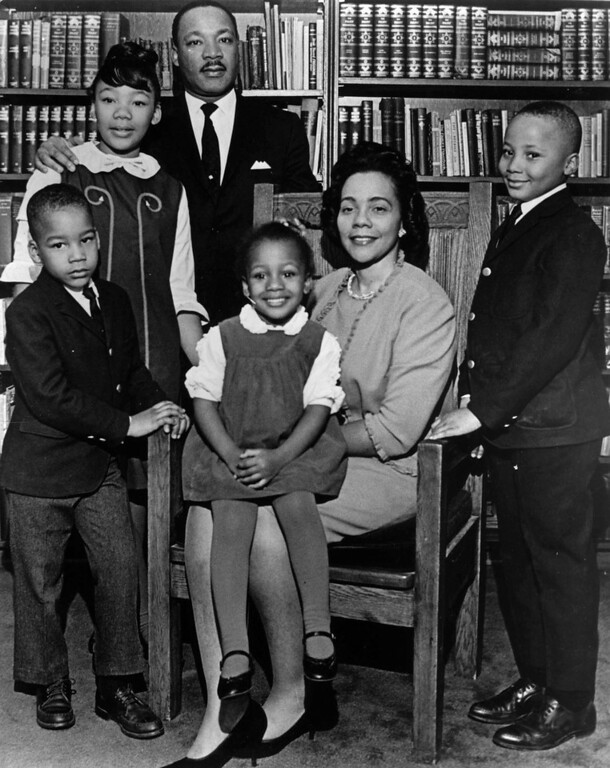 ". This 1966 photo is the last official portrait taken of the entire King family, made in the study of Ebenezer Baptist Church in Atlanta. From left are Dexter King, Yolanda King, Martin Luther King Jr., Bernice King, Coretta Scott King and Martin Luther King III. In 1963, Martin Luther King Jr. declared, ""I have a dream that my four little children will one day live in a nation where they will not be judged by the color of their skin but by the content of their character.\"" (AP Photo/Atlanta Journal-Constitution)"