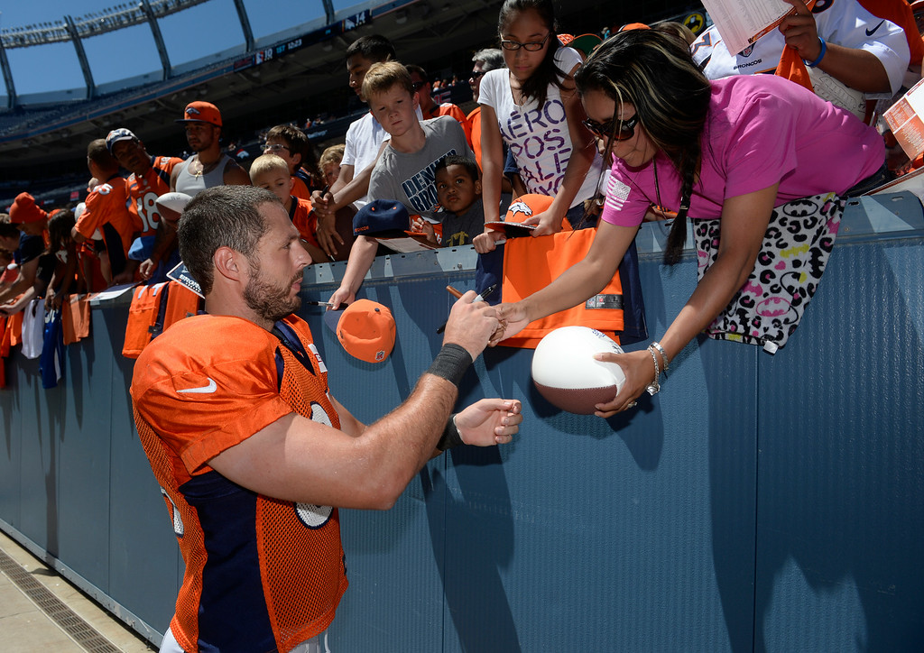 . Denver Broncos TE, Jacob Tamme, signs autographs for the fans after practice and scrimmage at Sports Authority Field at Mile High Saturday afternoon, August 02, 2014. (Photo By Andy Cross / The Denver Post)