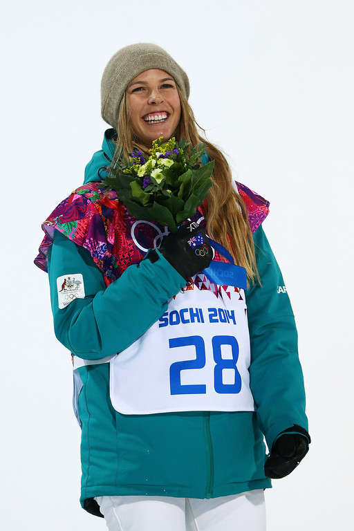 . Silver medalist Torah Bright of Australia celebrates during the flower ceremony for the Snowboard Women\'s Halfpipe Finals on day five of the Sochi 2014 Winter Olympics at Rosa Khutor Extreme Park on February 12, 2014 in Sochi, Russia.  (Photo by Cameron Spencer/Getty Images)