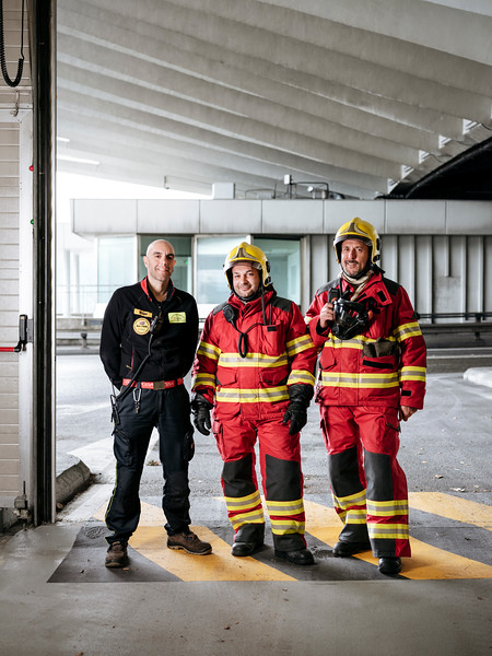 From left to right, Simone Vesan, Alex Paonna and Rudy Fassin direct response crew (professional firefighters) in the hangar on the French side, behind them the French access (tunnel entrance) - Samuel Zeller for the New York Times