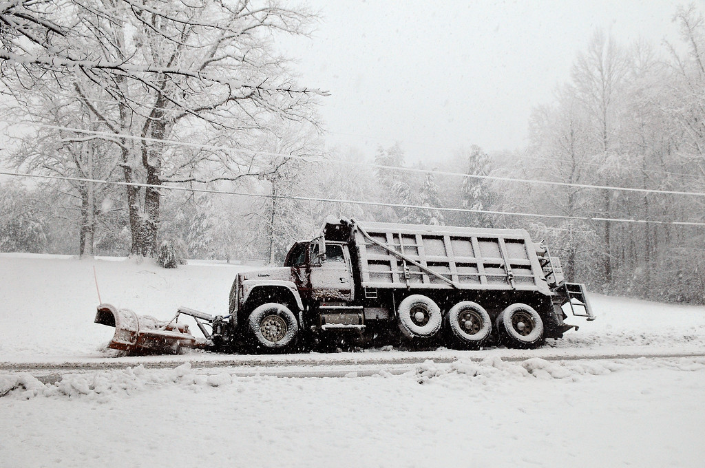 . A snow plow rests in a ditch after sliding off of Brock Road in Spotsylvania,Va., Wednesday March 6, 2013.  Gov. Bob McDonnell declared a state of emergency Wednesday as up to 20 inches of snow piled up in parts of central and western Virginia. (AP Photo/The Free Lance-Star,Dave Ellis )
