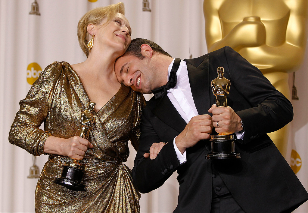 ". In this Feb. 26, 2012 file photo, best actress Meryl Streep, left, for ""The Iron Lady\"" and best actor Jean Dujardin for \""The Artist\"" pose with their awards during the 84th Academy Awards in the Hollywood section of Los Angeles. (AP Photo/Joel Ryan, File)"