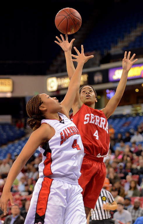 . Serra High School\'s Deandrea Toler puts up a shot over Mariya Moore of Salesian High during the Division IV 2013 CIF State Basketball Championships at Sleep Train Arena, in Sacramento, Ca March 23, 2013.  Serra won the game 62-60.(Andy Holzman/Los Angeles Daily News)