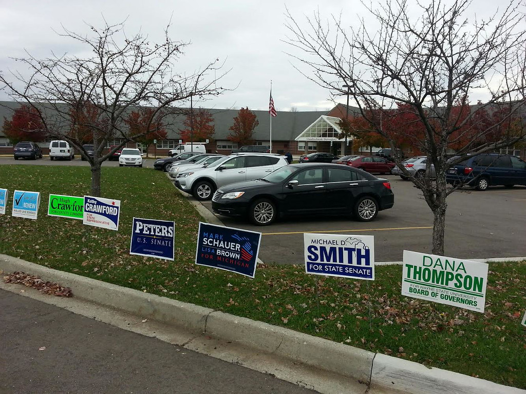 . Signs greet voters at Meadowbrook Elementary in Novi. (Dave Phillips / The Oakland Press)