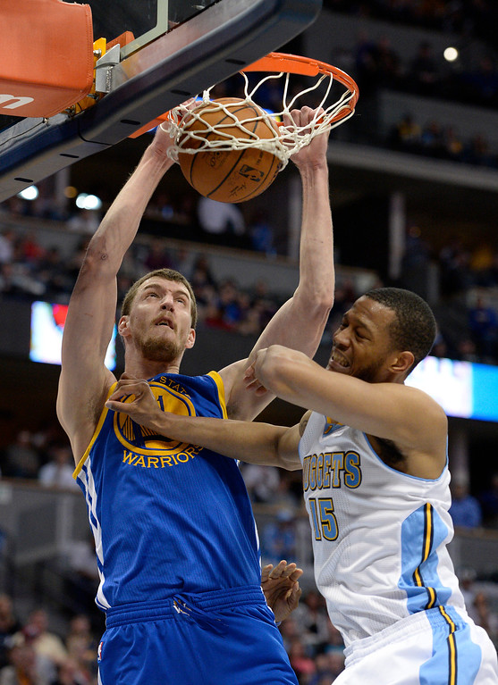 . DENVER, CO - APRIL 16: Golden State Warriors center Ognjen Kuzmic (1) gets a big dunk on Denver Nuggets forward Anthony Randolph (15) during the fourth quarter April 16, 2014 at Pepsi Center. Golden State Warriors defeated the Denver Nuggets 116-112. (Photo by John Leyba/The Denver Post)
