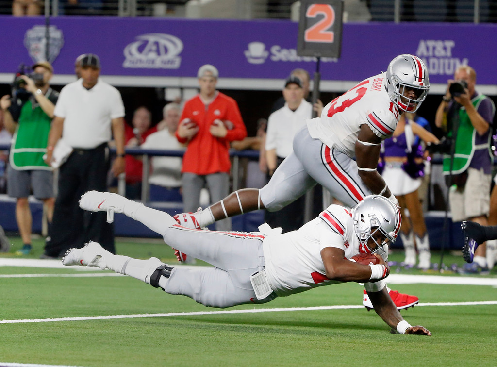 . Ohio State quarterback Dwayne Haskins (7) scores a touchdown against TCU during the second half of an NCAA college football game in Arlington, Texas, Saturday, Sept. 15, 2018. Ohio State won 40-28. (AP Photo/Michael Ainsworth)