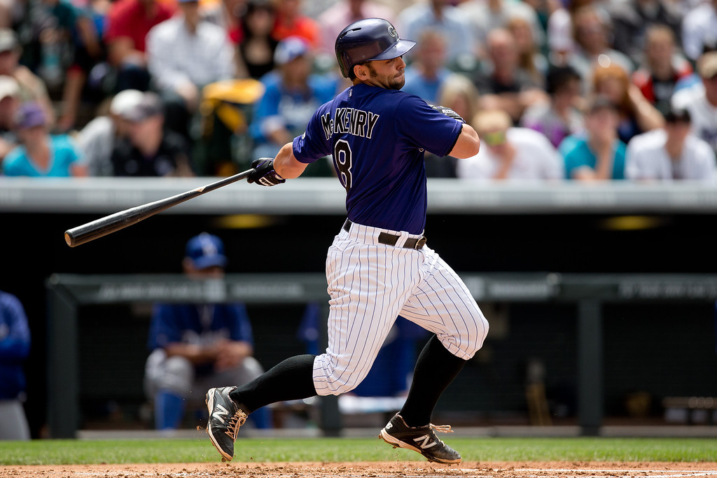 . DENVER, CO - JUNE 7:  Michael McKenry #8 of the Colorado Rockies watches his RBI single during the second inning against the Los Angeles Dodgers at Coors Field on June 7, 2014 in Denver, Colorado. (Photo by Justin Edmonds/Getty Images)