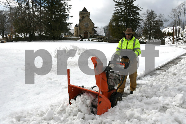 3/8/2018 Mike Orazzi | Staff Jim Morrell while clearing snow in front front of the West Cemetery, Thursday in Bristol.