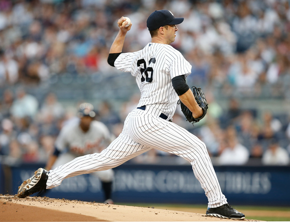 . New York Yankees starting pitcher Chris Capuano delivers in a baseball game against the Detroit Tigers at Yankee Stadium in New York, Wednesday, Aug. 6, 2014.  (AP Photo/Kathy Willens)