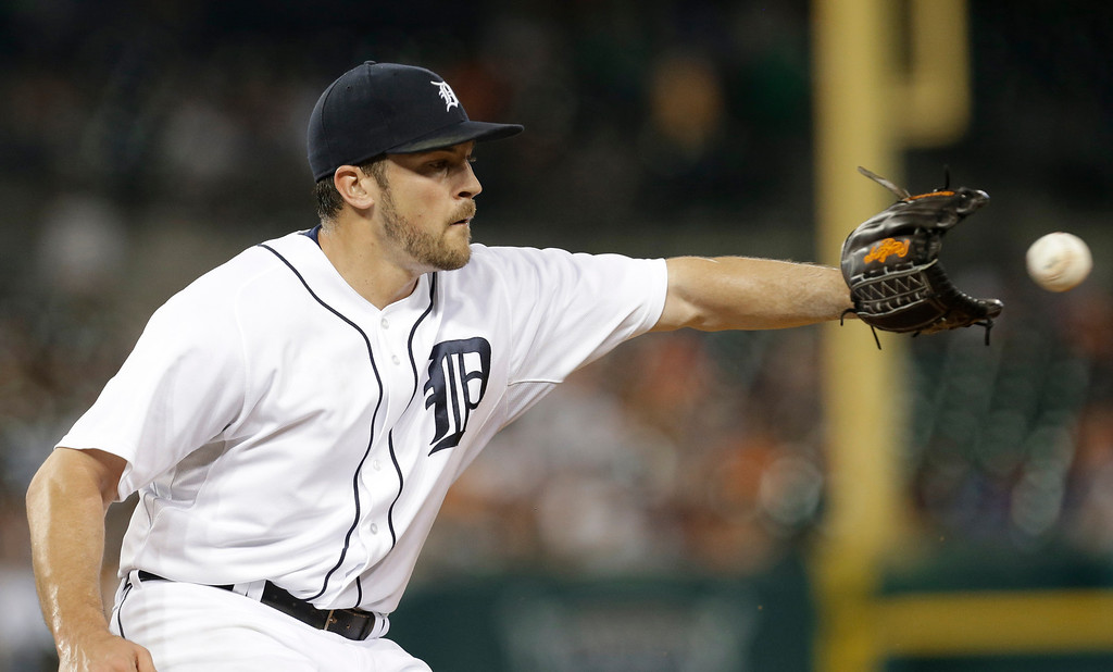 . Detroit Tigers relief pitcher Evan Reed covers first base for an out against the Kansas City Royals in the seventh inning of a baseball game in Detroit, Tuesday, June 17, 2014.  (AP Photo/Paul Sancya)
