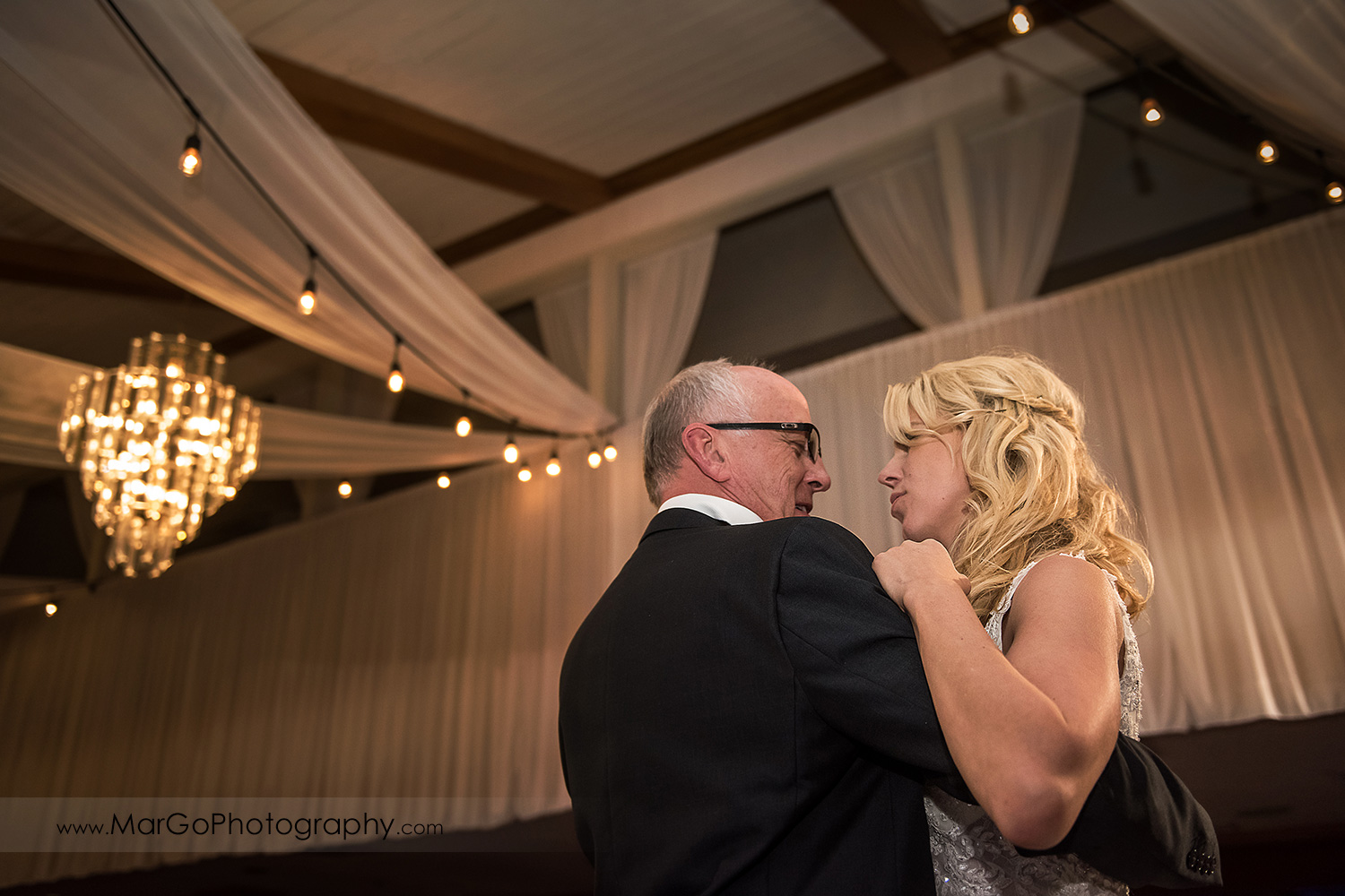 bride dancing with her father during wedding reception at San Diego Marina Village