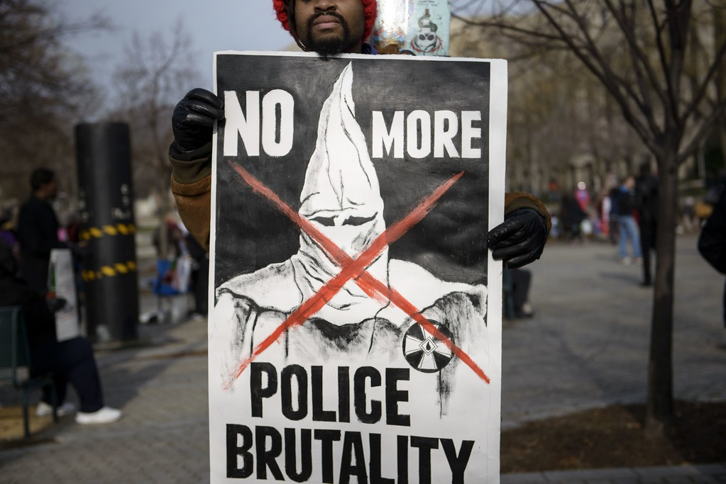 ". A protester holds a sign during the ""Justice For All\"" march December 13, 2014 in Washington, DC. Thousands of people descended on Washington to demand justice Saturday for black men who have died at the hands of white police, the latest in weeks of demonstrations across the United States.  AFP PHOTO/BRENDAN  SMIALOWSKI/AFP/Getty Images"