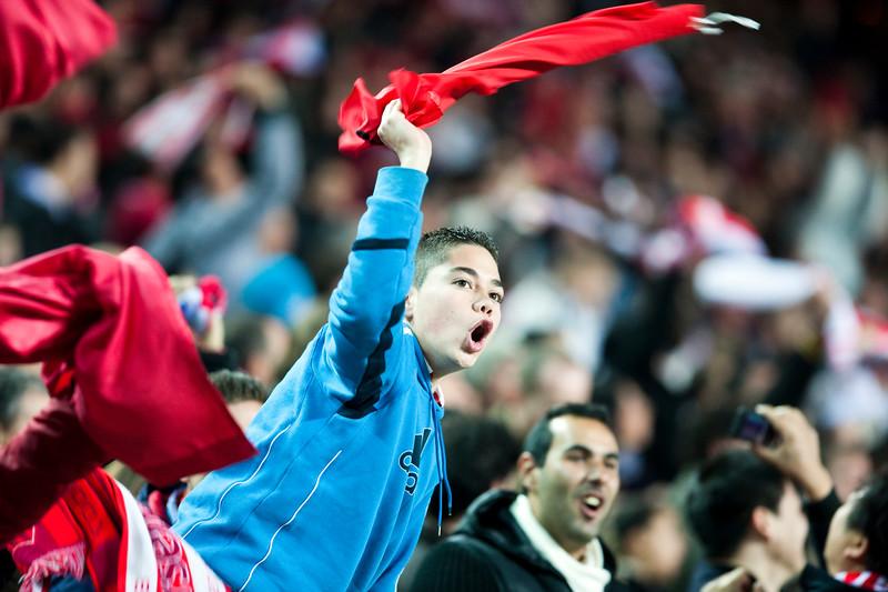 Young Sevilla FC fan celebrates a goal. Spanish Liga game between Sevilla FC and Valencia CF. Sanchez Pizjuan stadium, Seville, Spain, 31 January 2010