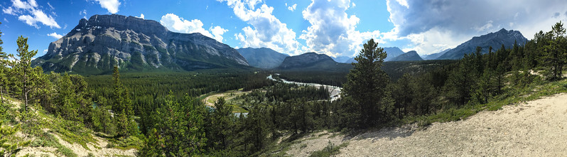 """Panorama of the view from the hoodoo's trail. Here you can see Mt. Rundle, the Bow river, and a number of other peaks. You might even be able to see the famous """"Banff Springs Hotel"""" .. aka The Fairmont."""