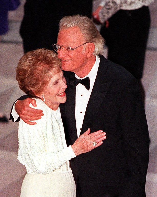 . Former US First Lady Nancy Reagan (L)  and Reverend Billy Graham embrace during the gala dedication of the Ronald Reagan Building and International Trade Center May 5 in Washinghton, DC.  Reagan, 87, was not present at the ceremony and has not appeared in public since he announced in 1994 that he had Alzheiner\'s disease.   (TIM SLOAN/AFP/Getty Images)