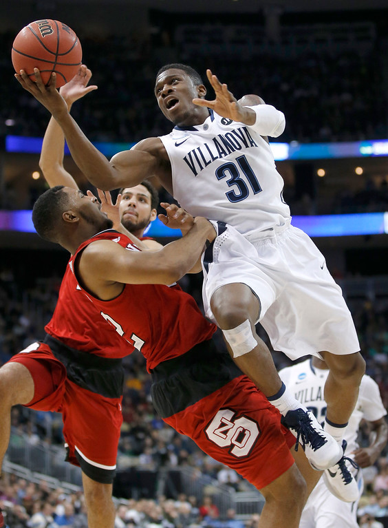 . Villanova\'s Dylan Ennis (31) shoots over North Carolina State\'s Ralston Turner, front left, during the first half of an NCAA tournament third-round college basketball game, Saturday, March 21, 2015, in Pittsburgh. (AP Photo/Gene J. Puskar)