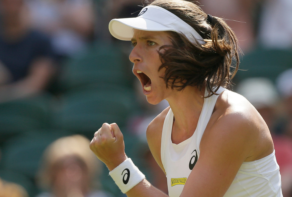 . Britain\'s Johanna Konta celebrates winning a point against Slovakia\'s Dominika Cibulkova during their women\'s singles match, on the fourth day of the Wimbledon Tennis Championships in London, Thursday July 5, 2018. (AP Photo/Tim Ireland)