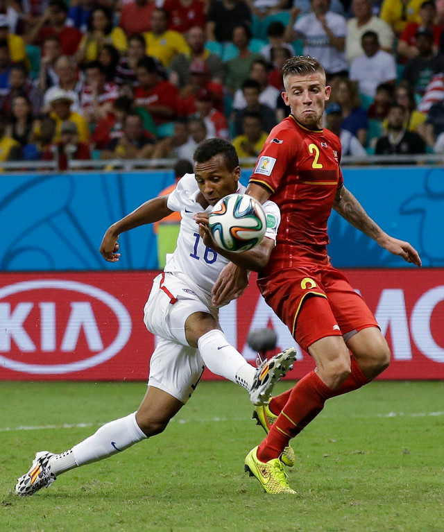 . United States\' Julian Green, left, scores his side\'s first goal during the World Cup round of 16 soccer match between Belgium and the USA at the Arena Fonte Nova in Salvador, Brazil, Tuesday, July 1, 2014. (AP Photo/Matt Dunham)