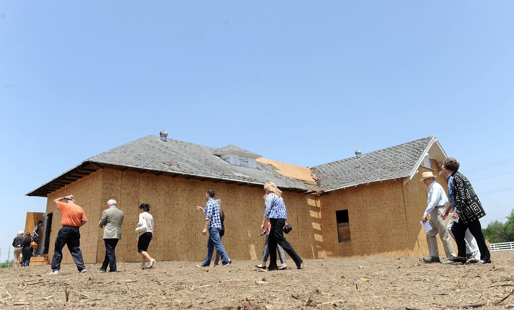 . (John Valenzuela/Staff Photographer) A group of people walk to the recently renovated Barton School House in Redlands, to tour the inside during an open house for first phase completion of the school, Friday, May 24, 2013.  Contractor Roger Smart and Architect Shan McNaughton have worked together to resurrect the historic school house.