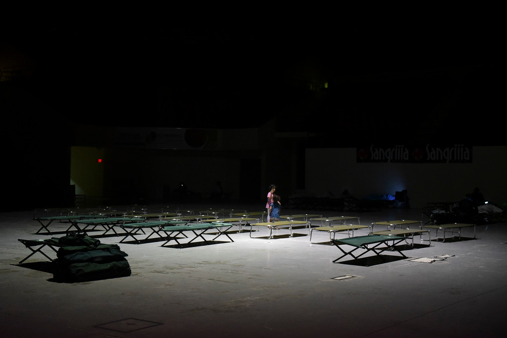 . Two girls play on cots at Humacao Arena refugee center while waiting for the imminent impact of Maria, a Category 5 hurricane that threatens to hit the eastern region of the island with sustained winds of 175 miles per hour, in Humacao, Puerto Rico, Tuesday, September 19, 2017. About 137 citizens arrived at the refuge from different parts of the eastern region of the Island. (AP Photo/Carlos Giusti)
