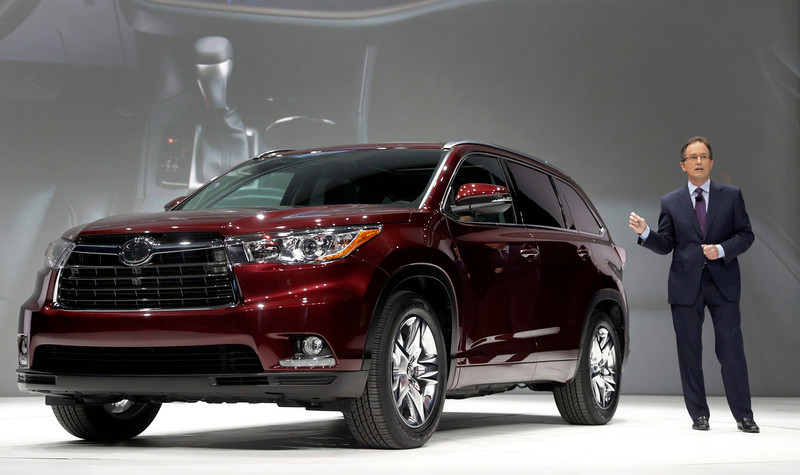 . Bill Fay, Group Vice President and General Manager, Toyota Division of Toyota Motor Sales, U.S.A., presents the 2014 Toyota Highlander at the New York International Auto Show, in New York\'s Javits Center,  Wednesday, March 27, 2013. (AP Photo/Richard Drew)