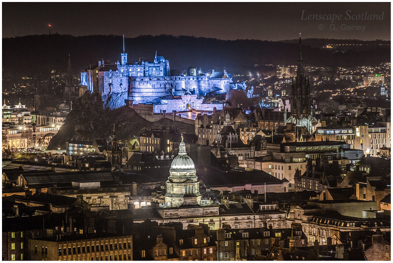 Edinburgh Castle and Old College dome from Salisbury Crags
