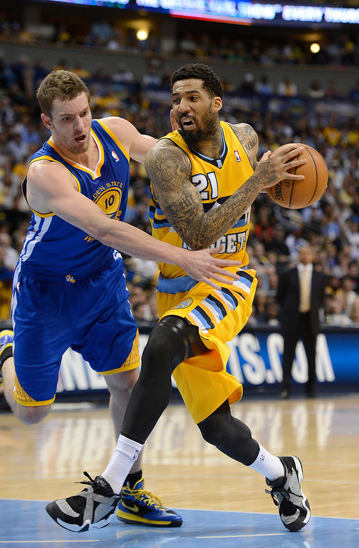 . DENVER, CO. - APRIL 20: Denver Nuggets shooting guard Wilson Chandler (21) drives to the basket against Golden State Warriors power forward David Lee (10) in the second quarter. The Denver Nuggets took on the Golden State Warriors in Game 1 of the Western Conference First Round Series at the Pepsi Center in Denver, Colo. on April 20, 2013. (Photo by John Leyba/The Denver Post)
