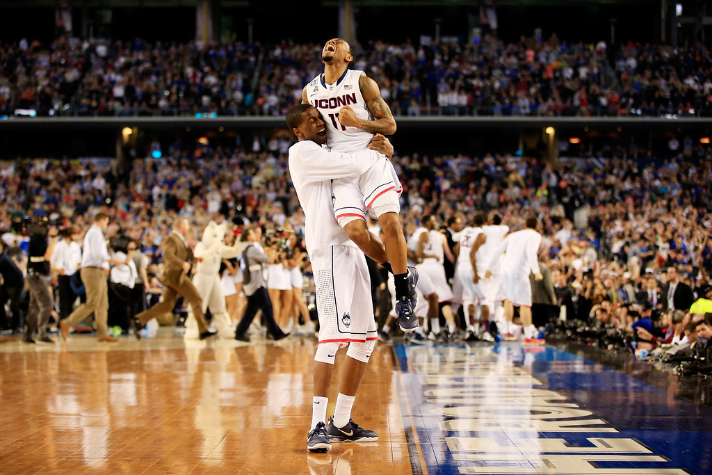 . ARLINGTON, TX - APRIL 07:  Ryan Boatright #11 of the Connecticut Huskies celebrates with a teammate after defeating the Kentucky Wildcats 60-54 in the NCAA Men\'s Final Four Championship at AT&T Stadium on April 7, 2014 in Arlington, Texas.  (Photo by Jamie Squire/Getty Images)