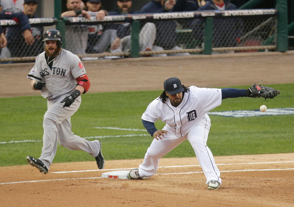. Boston Red Sox\'s Jonny Gomes is safe at first as Detroit Tigers\' Prince Fielder takes the throw from Jhonny Peralta in the fifth inning during Game 3 of the American League baseball championship series Tuesday, Oct. 15, 2013, in Detroit. (AP Photo/Charlie Riedel)