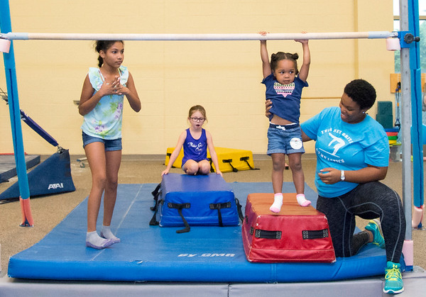 08/22/19 Wesley Bunnell | Staff The New Britain YWCA held an open house on Thursday August 22, 2019 to showcase the programs and benefits for prospective members by having them visit scavenger hunt stations each with a different theme. Alexa Rodriguez age 9 and Cadence Brodie age 2, take their turn at a gymnastics station under the watch of coach Jaylah Green as Payton Castiglione age 6 looks on.