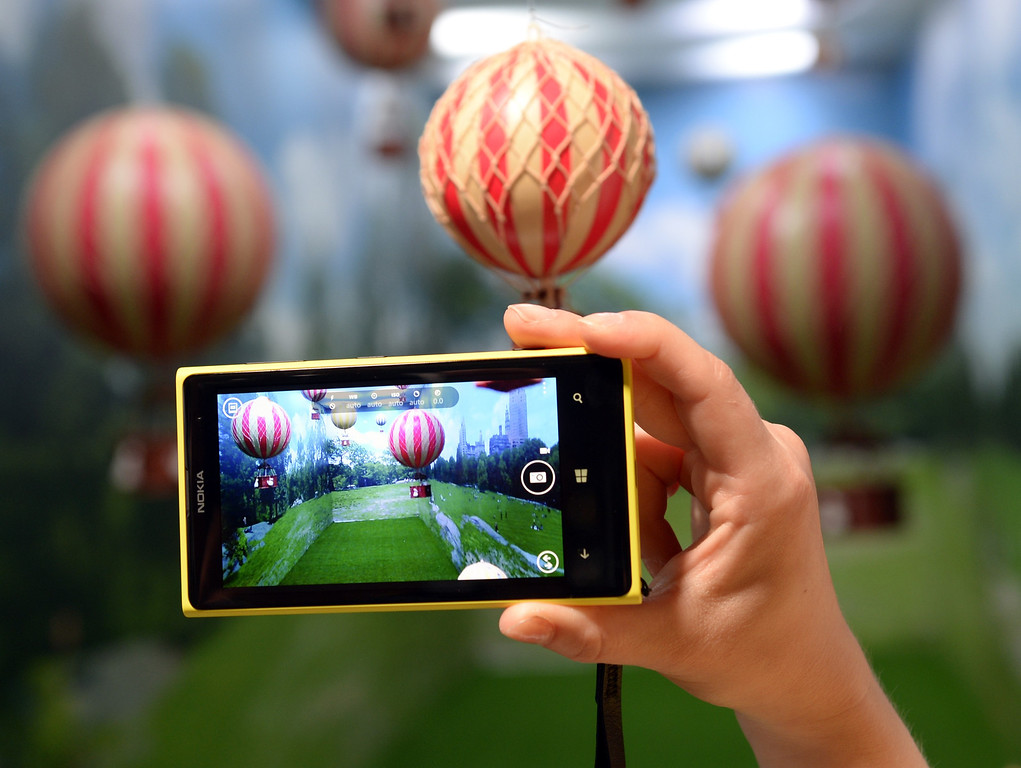 . A employee demonstrates the photo capabilities of the Nokia Lumia 1020, a Windows Phone with a 41-megapixel camera after its unveiling in New York City July 11, 2013.  (The Lumia 1020 will also be available globally.)   AFP PHOTO / TIMOTHY  CLARY/AFP/Getty Images