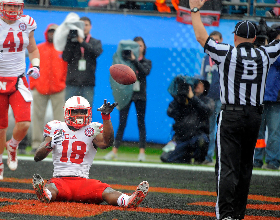 . Nebraska wide receiver Quincy Enunwa (18) tossed the ball to an official after scoring a touchdown during the first half of the Gator Bowl NCAA college football game against Georgia, Wednesday, Jan. 1, 2014, in Jacksonville, Fla. (AP Photo/Stephen B. Morton)