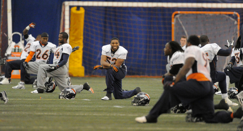 . Denver Broncos outside linebacker Wesley Woodyard (52) smiles during practice in the bubble Wednesday, December 19, 2012 at Dove Valley as they prepare for the Cleveland Browns.  John Leyba, The Denver Post