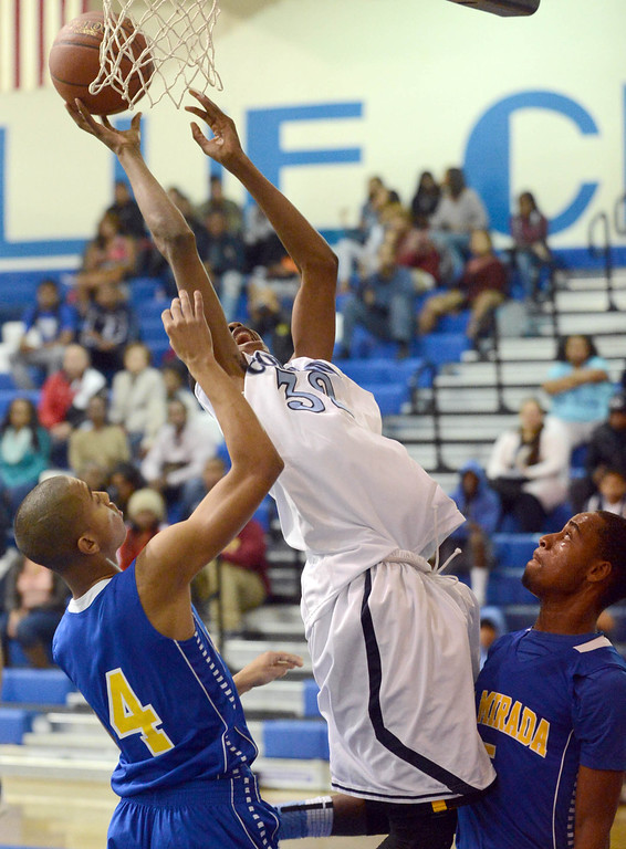 . Compton\'s Raysean Scott (32) puts up a difficult shot against La Mirada in a first round CIF Division 3AAA basketball game Wednesday night in Compton. 20130213 Photo by Steve McCrank / Staff Photographer