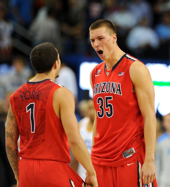 . Arizona\'s Gabe York, left, and Kaleb Tarczewski celebrate beating UCLA 79-75, Thursday, January 9, 2014, at Pauley Pavilion. (Photo by Michael Owen Baker/L.A. Daily News)