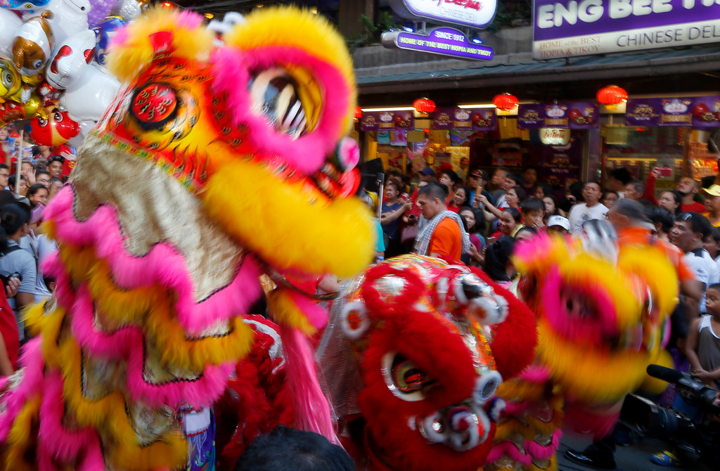 . Lion dancers perform at Manila\'s Chinatown district in celebration of the Chinese Lunar New Year Friday, Feb. 16, 2018 in Manila, Philippines. This year is the Year of the Dog in the Chinese Lunar calendar. (AP Photo/Bullit Marquez)