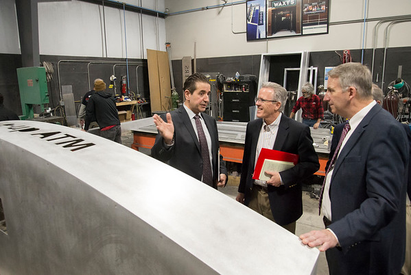 02/10/20 Wesley Bunnell | StaffrrCT State Chief Manufacturing Officer Colin Cooper visited Sign Pro, Inc. in Southington on Monday February 10, 2020. Sign Pro President Peter Rappoccio, L, discusses different projects with Cooper, middle.