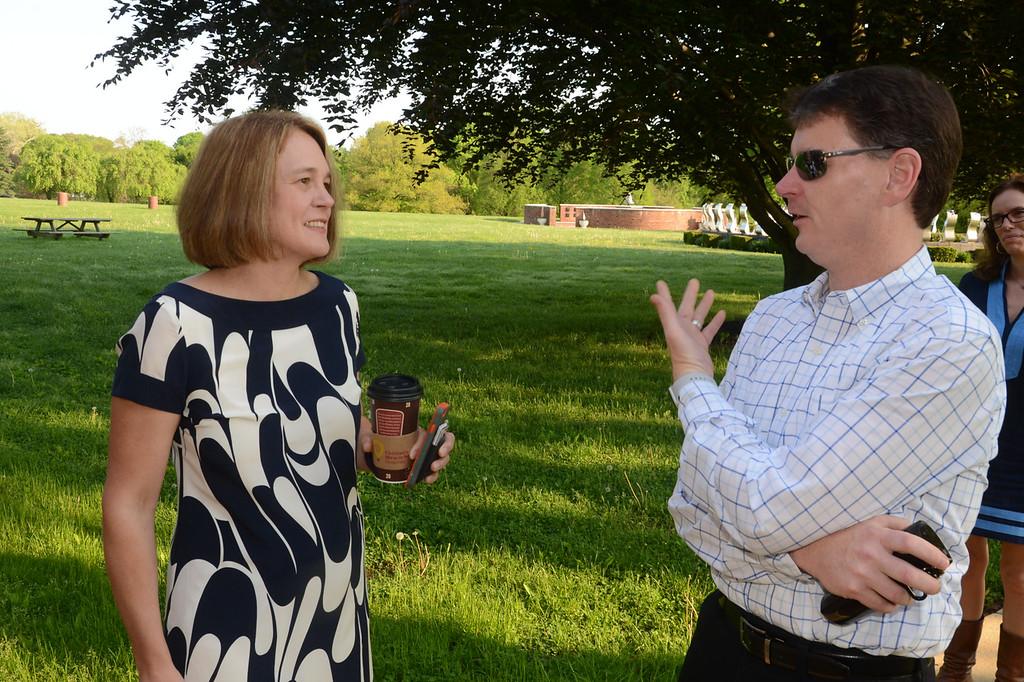 . PETE  BANNAN-DIGITAL FIRST MEDIA       Ashley Linkenheimer speaks with Alan Gregg at  the polls at Rose Tree Park Tuesday morning.