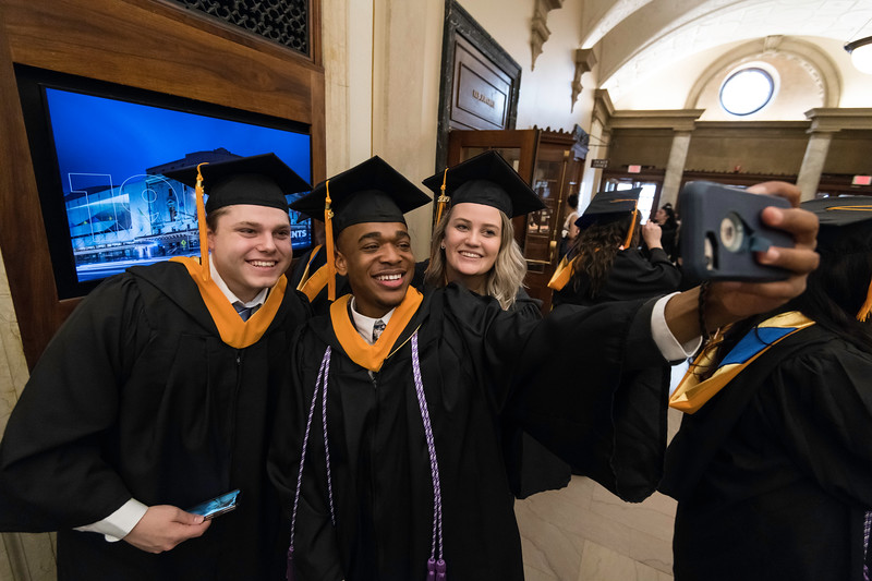 Corey Parker (C) takes a selfie with Lauren Gotsch and Michael Massina as Graduates get ready in Lowry Hall before the ceremony. // University of Rochester School of Nursing Commencement, Kodak Hall at Eastman Theatre May 17, 2019.  // photo by J. Adam Fenster / University of Rochester