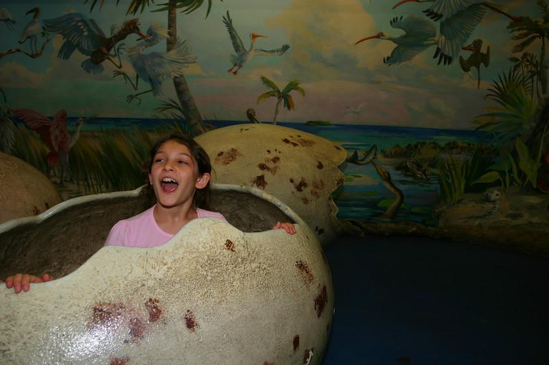 Anisa in the dinosaur egg.