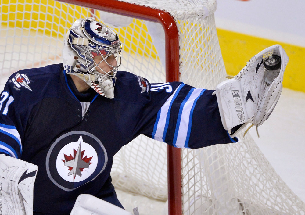 Description of . Winnipeg Jets goaltender Ondrej Pavelec makes a save against the Ottawa Senators during the third period of their NHL hockey game in Winnipeg January 19, 2013. REUTERS/Fred Greenslade