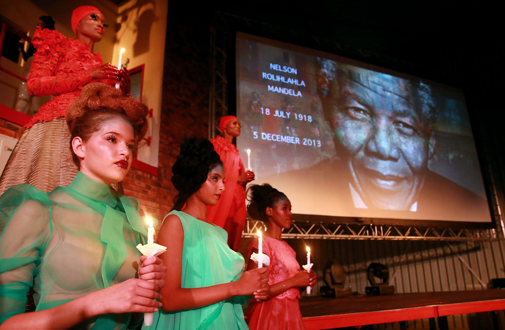 . Models pay a special tribute to late former South African President Nelson Mandela during the Kwazul-Natal David Tlale Fashion Extravaganza held in Durban on December 6, 2013. Mandela, the revered icon of the anti-apartheid struggle in South Africa and one of the towering political figures of the 20th century, has died aged 95. Mandela, who was elected South Africa\'s first black president after spending nearly three decades in prison, had been receiving treatment for a lung infection at his Johannesburg home since September, after three months in hospital in a critical state.    AFP PHOTO /RAJESH  JANTILAL/AFP/Getty Images