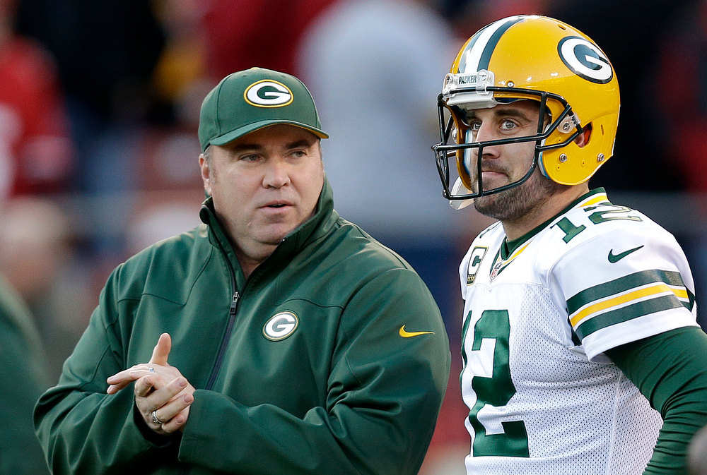 . Green Bay Packers head coach Mike McCarthy talks with quarterback Aaron Rodgers (12) before an NFC divisional playoff NFL football game against the San Francisco 49ers in San Francisco, Saturday, Jan. 12, 2013. (AP Photo/Marcio Jose Sanchez)