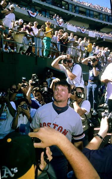 Photographers surround Boston Red Sox pitcher Roger Clemens after he got thrown out of a playoff gane with the Oakland A's for arguing with the umpire.  Hayward Daily Review/Dino Vournas