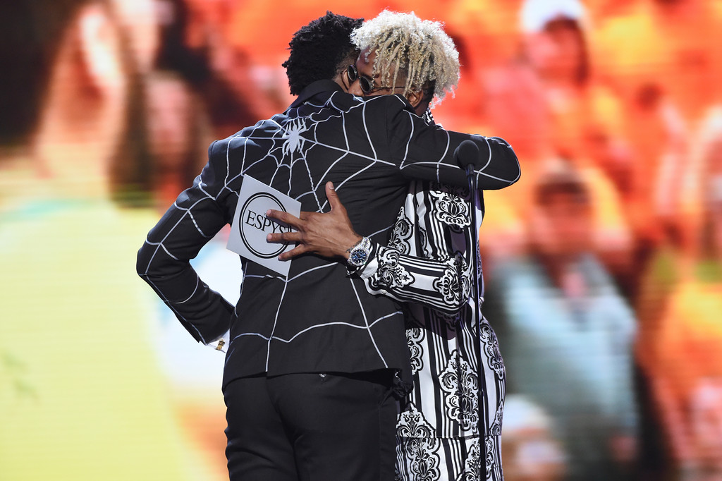. Utah Jazz\'s Donovan Mitchell, left, accepts the award for best breakthrough athlete from Odell Beckham Jr. at the ESPY Awards at Microsoft Theater on Wednesday, July 18, 2018, in Los Angeles. (Photo by Phil McCarten/Invision/AP)